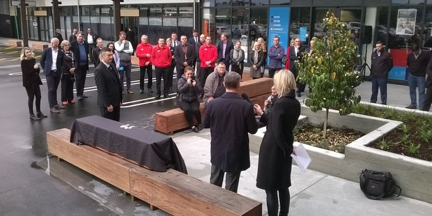 Loading Officials gather to unveil the plaque at Tauranga Crossing this morning as the Bay's newest retail hub formally opens. Photo/John Borren