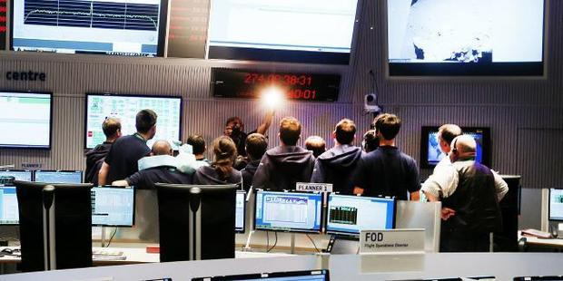 The ESA team in Germany watch the spacecraft descend towards the comet. Picture: AP Photo/Michael ProbstSource:AP