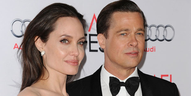 Brad Pitt and Angelina Jolie have reportedly agreed to a temporary custody deal. Photo / Getty Images