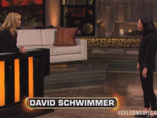 Courteney Cox pretends to be David Schwimmer.