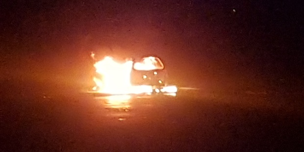 A car was well ablaze when Red Hill resident Corey Hampson woke up at 5am. Photo/Supplied
