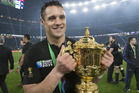 Dan Carter with the Rugby World Cup trophy. Photo / Brett Phibbs
