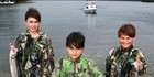 Medcalfe brothers Gabriel, 11, Zion, 9, and Jono, 7, show of their catches at Boatshed Bay. Photo / supplied