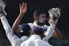 India's Ravichandran Ashwin, centre, celebrates wicket of New Zealand's Kane Williamson. Photo / AP