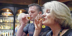Foreign tourists try Nikka whisky at Nikka's Yoichi Distillery in Yoichi, Hokkaido. Photo / Japan News-Yomiuri
