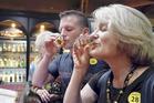 Foreign tourists try Nikka whisky at Nikka's Yoichi Distillery in Yoichi, Hokkaido. Photo / Japan News-Yomiuri