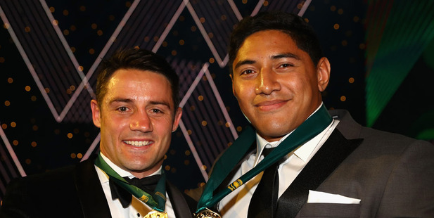 Cooper Cronk of the Melbourne Storm and Jason Taumalolo of the North Queensland Cowboys pose after being announced joint winners of the 2016 Dally M Medal. Photo / Getty