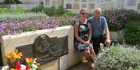 Ron Batten (right), great-nephew of aviatrix Jean Batten, at her grave in Majorca, Spain with his daughter, Shannon Marsh. Picture / Supplied.