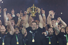 Richie McCaw lifts the Rugby World Cup trophy. Photo / Brett Phibbs
