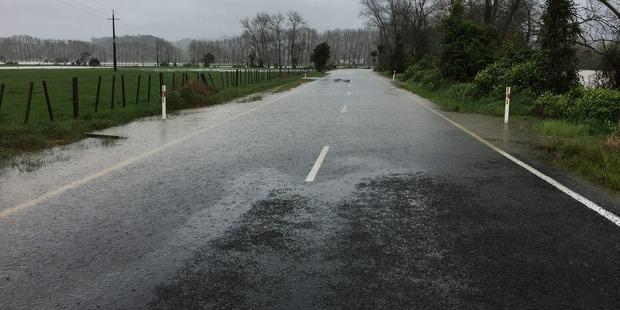 Flooding on the Hikuai Settlement Road out of Pauanui. Photo / Anna Poulgrain