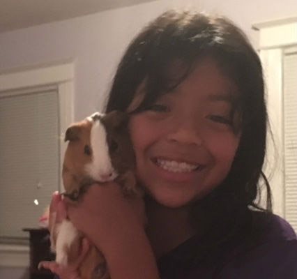 My daughter and her beloved guinea pig. Photo / Andrea Orr