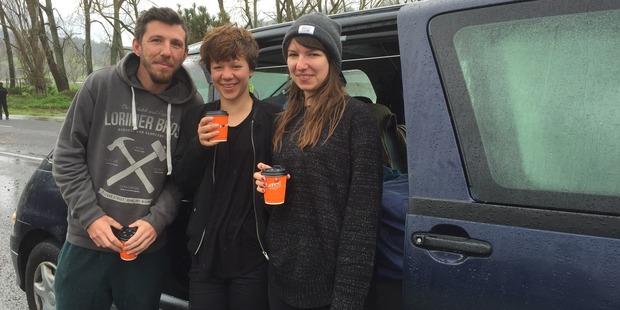 From left, Jeremy Dekeyser 27, of France, Iris Polker, 29, of Germany and Maria Schmidt, 26, of Germany slept in their car outside Prescott's Garage last night. Photo / Belinda Feek