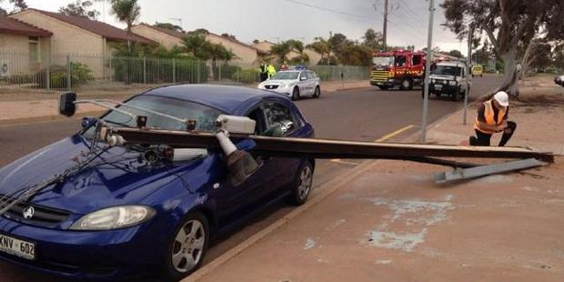 Winds over 80km/h brought down a power line on to a car in Port Augusta, SA. Photo / Lauren Rose, Southern Cross, Twitter