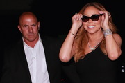 Mariah Carey's bodyguard keeps an eye on the paparazzi. Photo / Splash News Australia