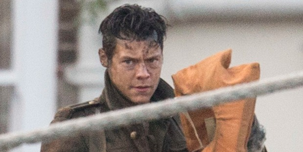 Harry Styles in WW2 army fatigues and muddy on the set of Chris Nolan's Dunkirk in Weymouth Harbour, Dorset, UK. Photo / Splash News