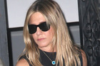 Jennifer Aniston protects herself with the