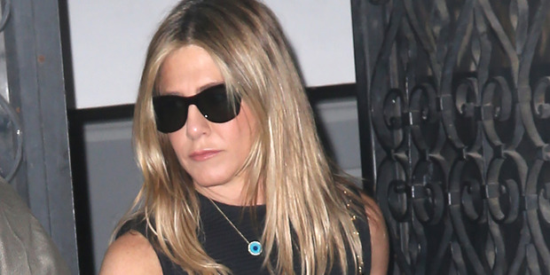 "Loading Jennifer Aniston protects herself with the ""Evil Eye"" necklace. Photo / Splash News Australia"