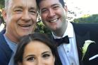 Actor Tom Hanks photobombs couple's wedding photo. Photo / Tom Hank's Instagram