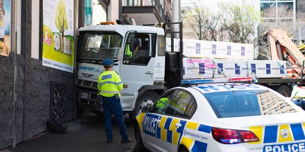Police attend an incident where a driver crashed into a building after his truck's brakes cut out as he was driving up Auckland's Queen St. Photo/ Mike Wheelton