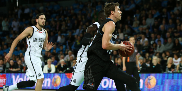 Tom Abercrombie takes the ball to the hoop in the Breakers' opener against Melbourne. Photo / photosport.nz