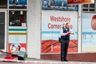 STANDING WATCH: A police officer at the scene of an armed robbery at the Westshore Corner Store yesterday. PHOTO/SUPPLIED