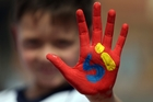 A boy promotes the Yes vote in Bogota. Photo / AP