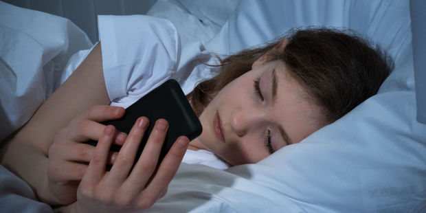 Can't stop checking my phone: children as young as nine are frequently checking their phones at night. Photo / 123rf