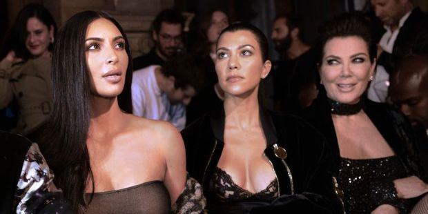 Kim Kardashian, Kourtney Kardashian, and Kris Jenner attending a fashion show in Paris. Photo / AFP