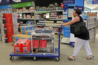 Kerri Vittimberga, of Wilton Manors, buys a generator, tarps and gas cans at Lowe's in Oakland Park, Florida, in preparation for the hurricane. Photo / AP