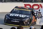 Martin Truex Jr does a burnout after winning a NASCAR Sprint Cup Series race at Dover. Photo / AP