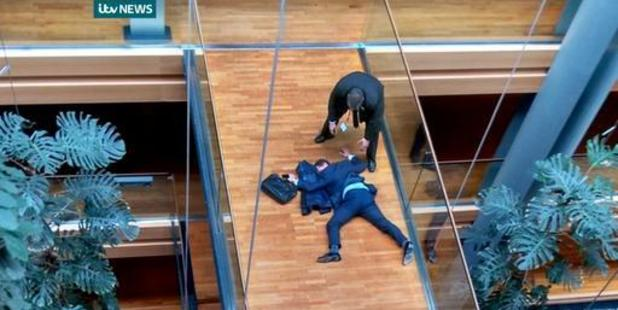 British UK Independence Party Member of the European Parliament Steven Woolfe lies on the ground after losing consciousness in the European Parliament. Photo / AP
