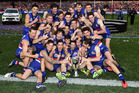 The Bulldogs celebrate winning Saturday's grand final against the Sydney Swans. Photo / AAP