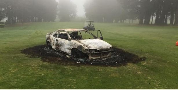 The wreck of a vehicle stolen in St Kilda and burned at the St Clair Golf Club. Photo / Patrick Moore.