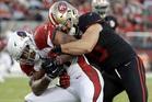San Francisco 49ers linebacker Nick Bellore, right, tackles Arizona Cardinals running back David Johnson. Photo / AP