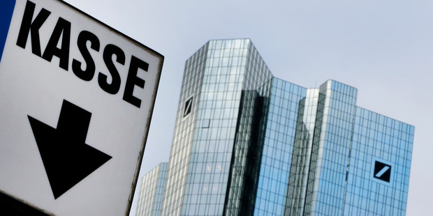 A sign reading cash point stands near the headquarters of Deutsche Bank in Frankfurt, Germany. Photo / AP