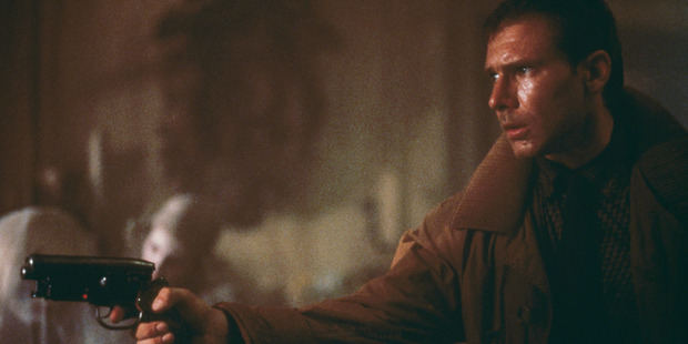 Blade runner Rick Deckard (Harrison Ford) enters Sebastian's apartment, where he is soon to be attacked by the replicant Pris (Daryl Hannah, immediately behind Deckard's gun). Photo / Getty