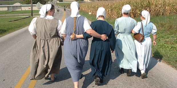 Five Amish women on their way to pray outside the schoolhouse in Nickel Mines, Pennsylvania, in October 2006. Photo / Getty