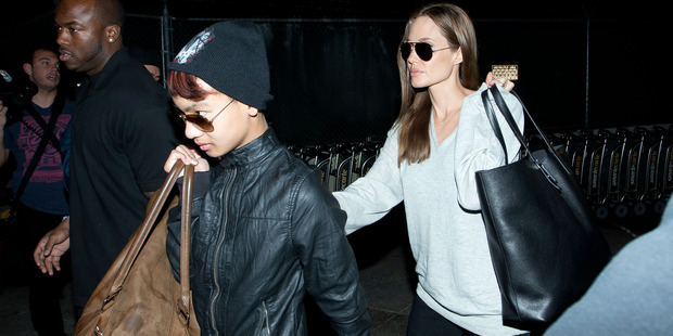 Maddox Jolie-Pitt and Angelina Jolie are seen at LAX airport on February 14, 2014 in Los Angeles, California. Photo / Getty