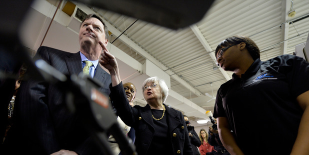 Federal Reserve Chair Janet Yellen, centre, and Federal Reserve Bank of Chicago President and CEO Charles Evans. Photo / Getty