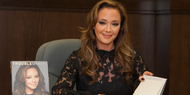 """Actress Leah Remini signs copies of her new book """"Troublemaker: Surviving Hollywood and Scientology. Photo / Getty"""