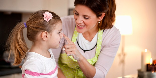 Baking is a great, interactive way to keep kids entertained, and it reaps a tasty reward at the end. Photo / Getty