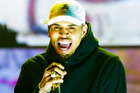 Though Chris Brown threw a duffel bag containing two guns out of his window during a stand-off with police, authorities can't definitively link the weapons to him. Photo / Getty Images