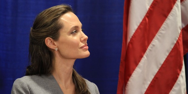 Actress Angelina Jolie, United Nations High Commissioner for Refugees (UNHCR) special envoy listens as US Secretary of State John Kerry speaks. Photo / Getty