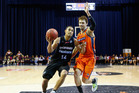 Mike Vukona of the Breakers takes the ball past Alex Loughton of the Taipans. Photo / Getty Images
