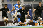 Dane Coles fires a flick pass away against Argentina. Photo / Getty
