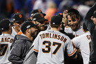 Madison Bumgarner celebrates with teammates after they defeated the New York Mets 3-0. Photo / Getty Images