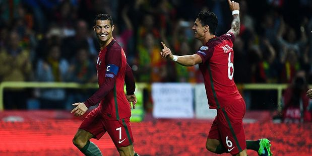Cristiano Ronaldo (L) of Portugal celebrates with his team mate Jose Fonte of Portugal after scoring his team's first goal. Photo / Getty