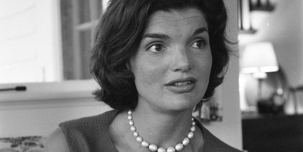 Close-up of American future First Lady Jacqueline Kennedy (1929 - 1994) as she sits in an armchair a thome in Hyannisport, Massachusetts, 1960. Photo / Getty