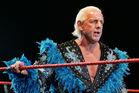 Ric Flair looks on while awaiting the entrance of Hulk Hogan during the Hulkamania Tour in Perth, Australia. Photo / Getty