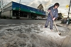 Ethna Renner Tamatea Rural Fire Force cleans up hail in the main street after a flash storm in Waipukurau. 2 October 2016. Sport. Hawke's Bay Today photograph by Warren Buckland